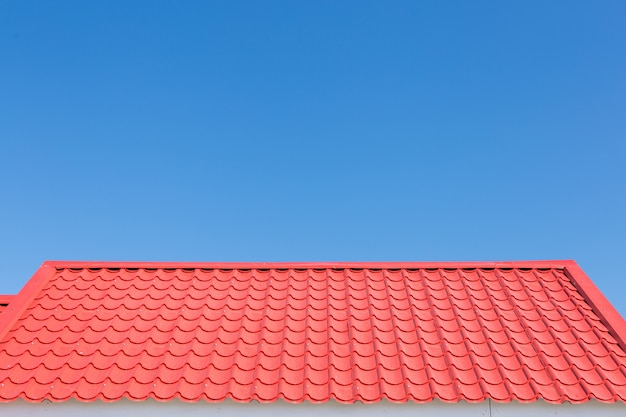Red roof with blue sky background