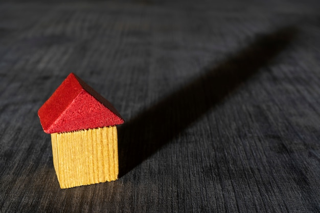 Red roof wooden toy house.