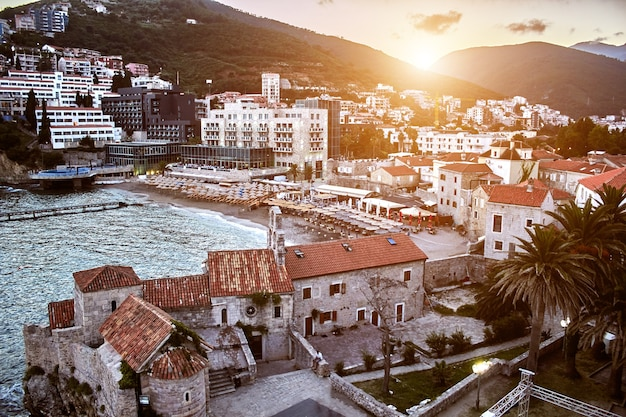 Red roofs of budva in montenegro. europe. travels. sun flare
