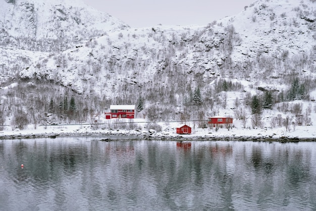 Red rorbu houses in norway in winter