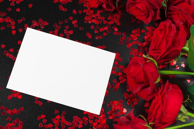 Red rose and blank gift card background