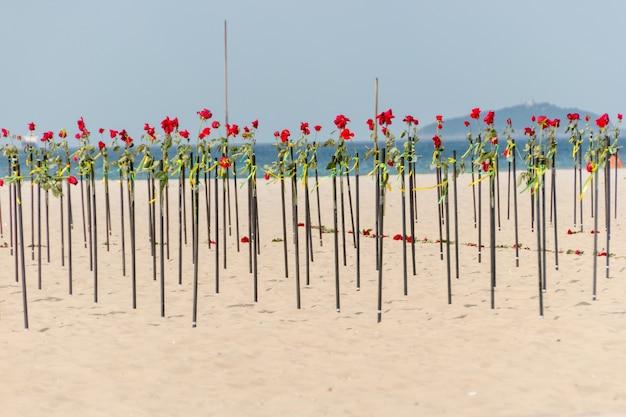 Red rose in the sand of copacabana beach in rio de janeiro brazil.