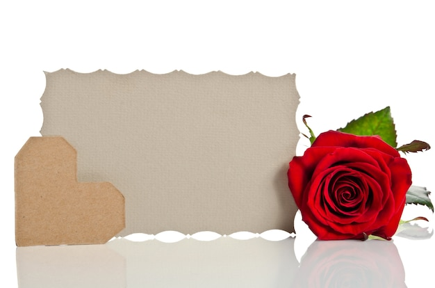 Red rose with blank sheet of paper