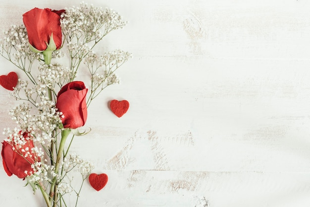 Red roses bouquet with heart and copy space