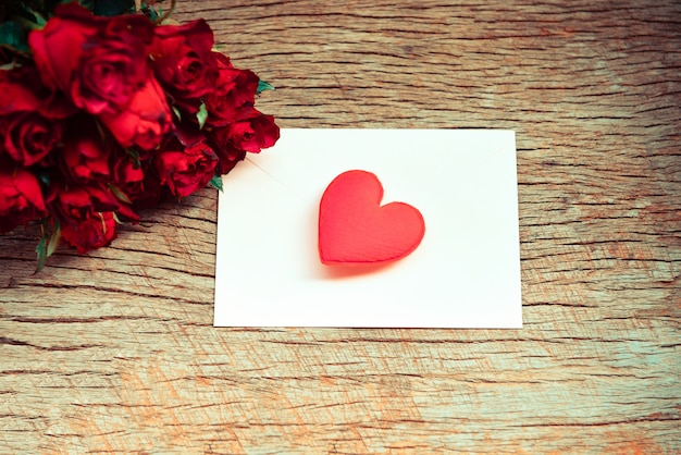 Red roses flower bouquet romantic love valentines day card envelope letter mail with red heart