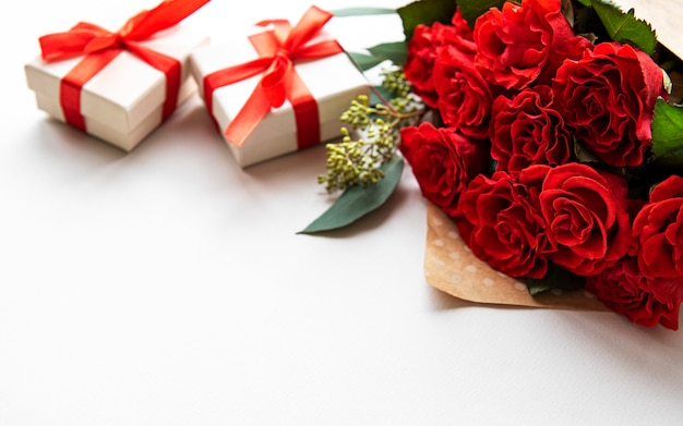Red roses and gift boxes