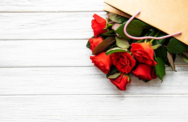 Red roses on a paper bag