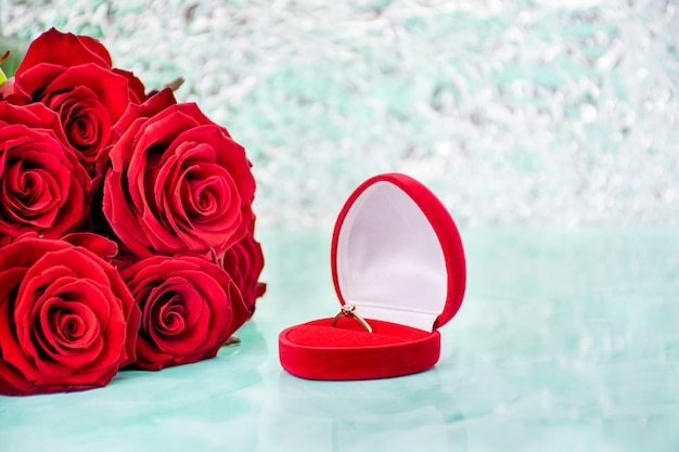 Red roses with boke background. box with a ring.