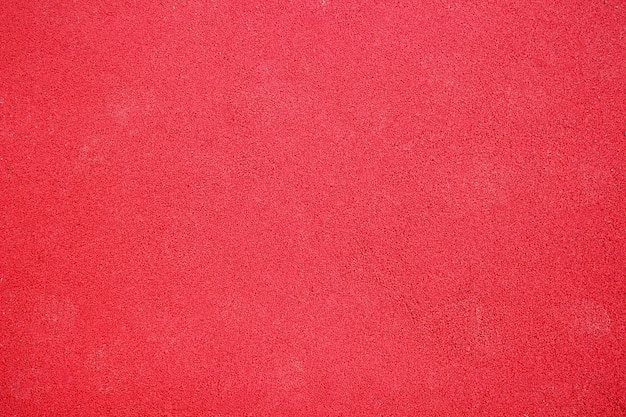 Red rubber coating of playground background, texture