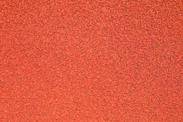 Red rubber running track background, top view