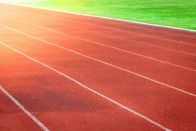 Red running track, white line in the stadium