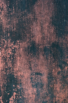Red rusty grunge metal background or texture with scratches and cracks