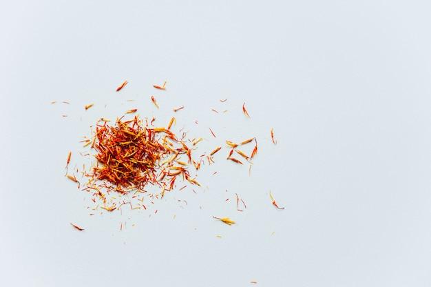 Red saffron threads on white background