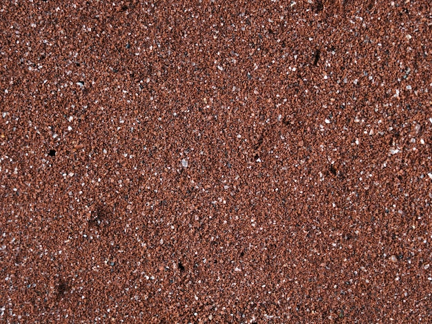 Spiaggia di sabbia rossa all'isola di rubina nel parco nazionale delle galapagos, ecuador