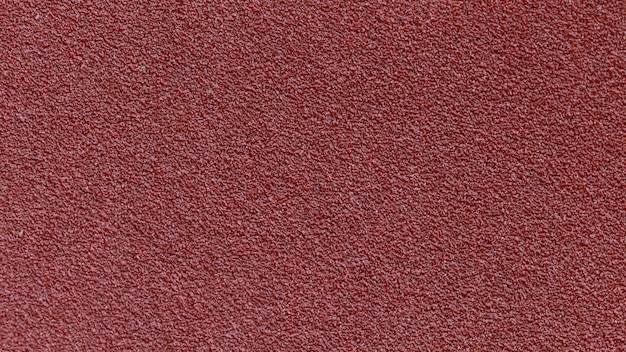 Red sandpaper texture background for industrial construction