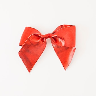 Red satin bow isolated on white background