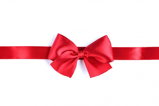 Red satin ribbon bow on white table