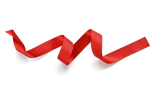 白い背景で隔離の赤いサテンリボン