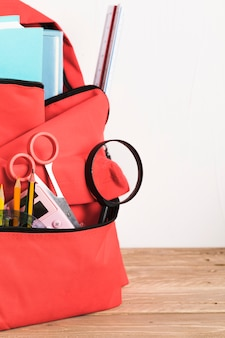 Red school backpack with essential supplies