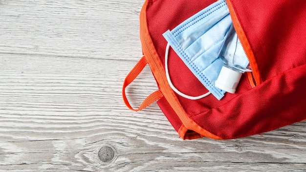 Red schoolbag with mask