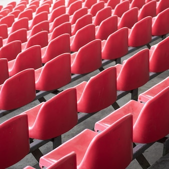 Red seats in the stadium. empty seat of football stadium.