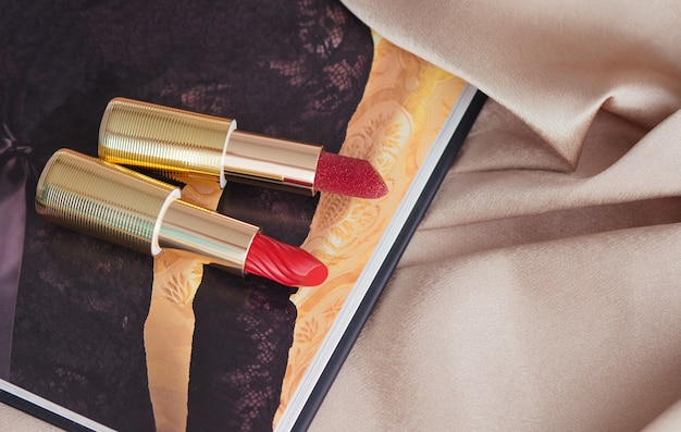 Red shiny lipstick on gold background