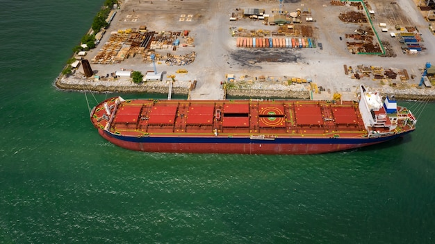 Red shipping repier in floating dock