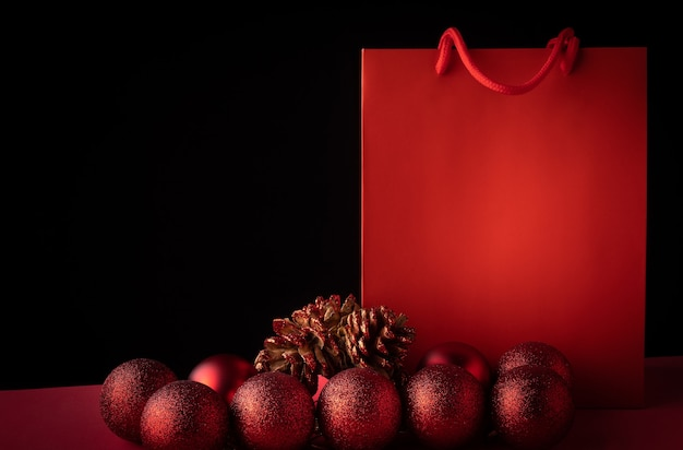 Red shopping bag on a christmas background