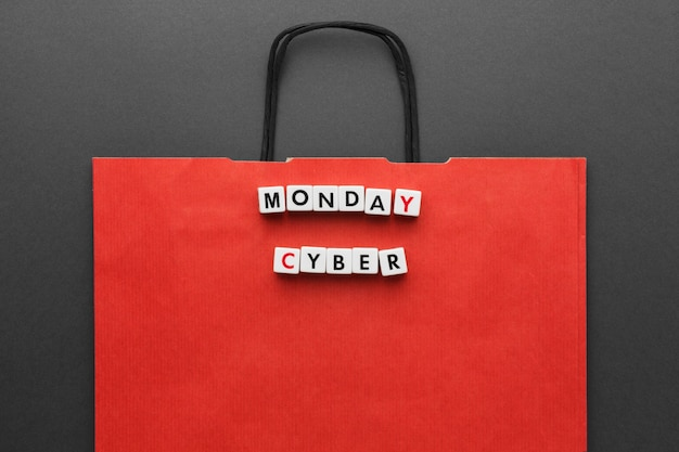 Red shopping bag and cyber monday written in scrabble letters
