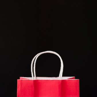 Red shopping bag on table