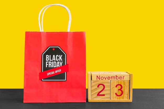 Red shopping bag with black friday inscription