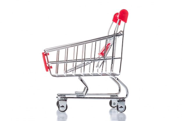 Red shopping cart trolley isolated.
