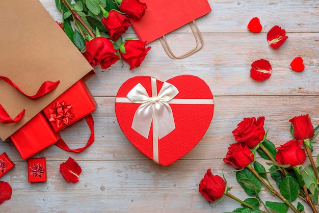 Red shopping craft bags with lovers gifts heartshaped gold foil packaging box roses