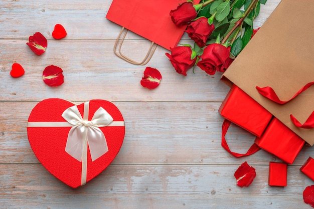 Red shopping craft bags with lovers gifts heartshaped packaging box roses and petals
