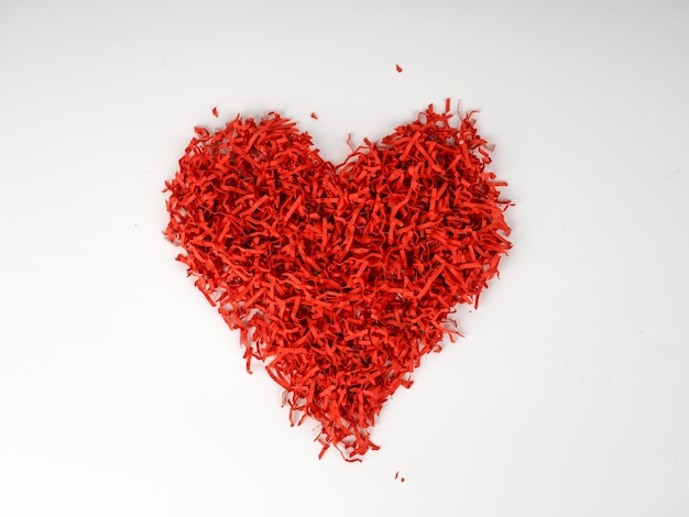 Red shredded paper in shape of heart