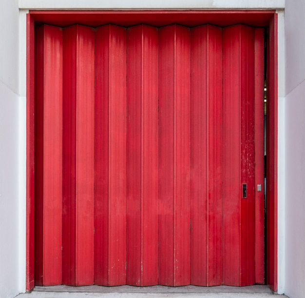 Red shutter striped door of warehouse