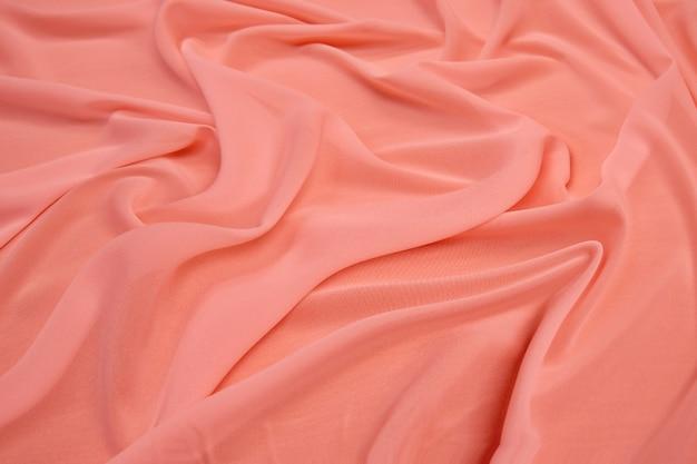 Красная шелковая ткань волны текстуры.