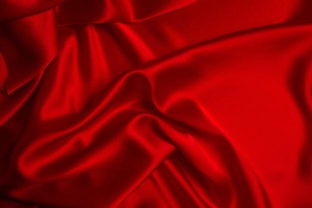 빨간색 실크 또는 새틴 고급 패브릭 질감은 추상적인 배경으로 사용할 수 있습니다. 평면도