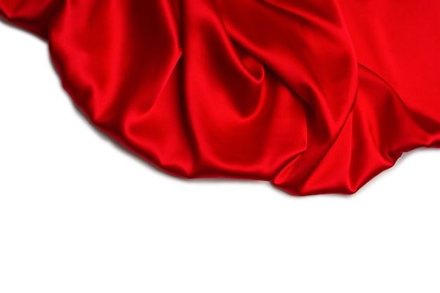 빨간색 실크 또는 새틴 고급 패브릭 질감 추상 배경으로 사용할 수 있습니다. 평면도.