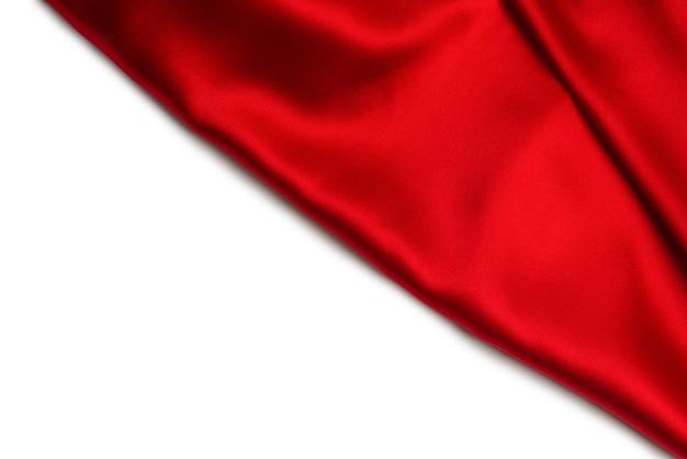 赤い絹またはサテンの豪華な生地の質感は、抽象的な背景として使用できます。上面図