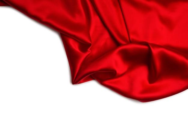 Красный шелк или атласную роскошную ткань можно использовать в качестве абстрактной стены. вид сверху.