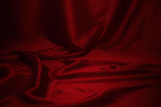 Красная шелковая или атласная текстура роскошной ткани
