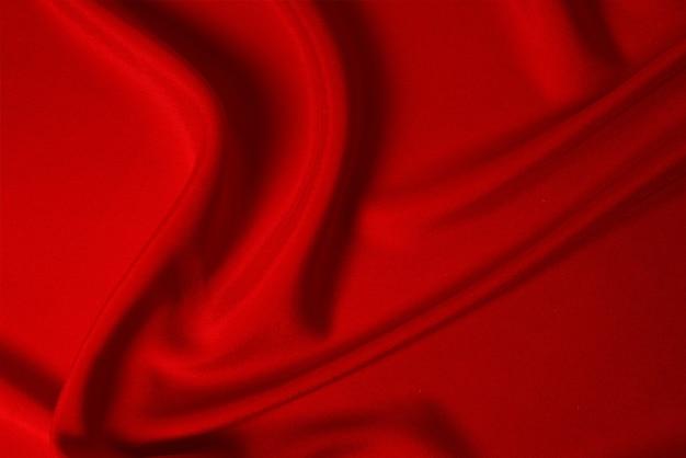 赤い絹またはサテンの高級生地の質感