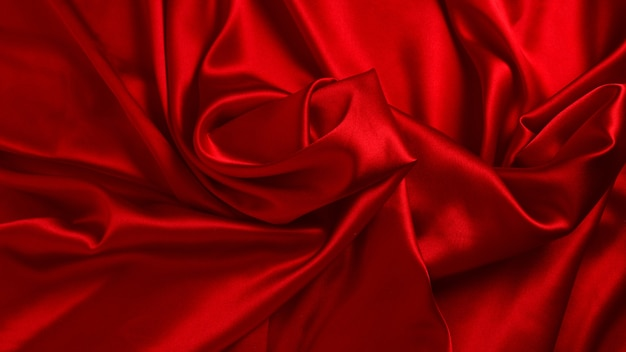 Red silk or satin luxury fabric texture background. top view.