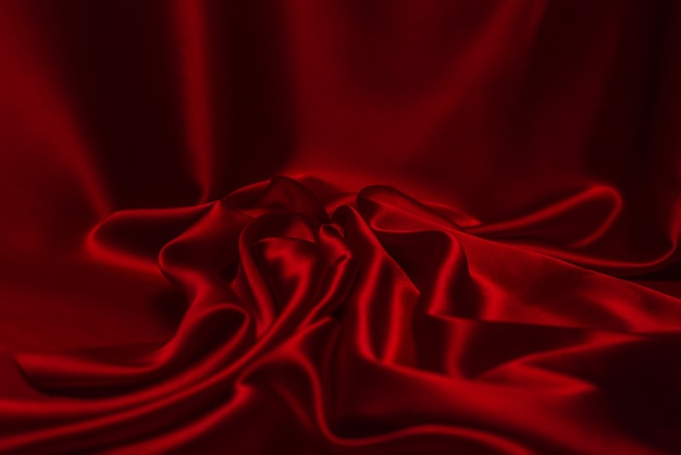 Red silk or satin luxury fabric texture background.
