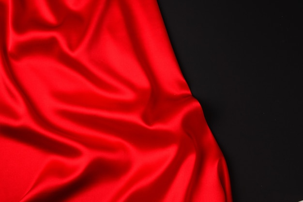 Red silk or satin luxury fabric texture can use as abstract background. top view