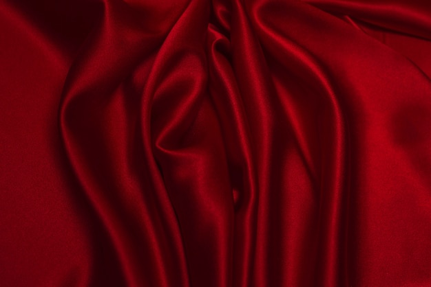 Red silk or satin luxury fabric texture