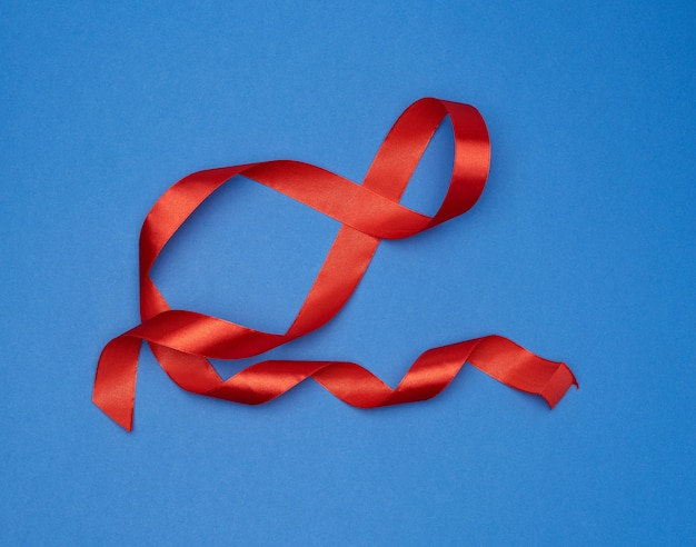 Red silk thin ribbon twisted on blue