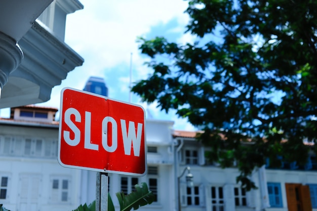 Red slow sign on the road Free Photo