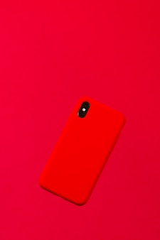 Red smartphone case against a red background